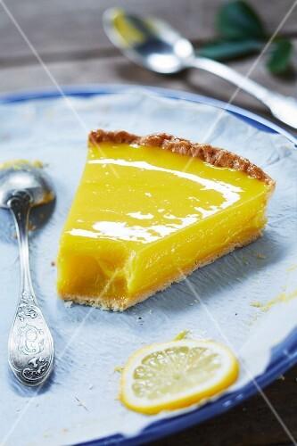 Eating a slice of lemon curd pie