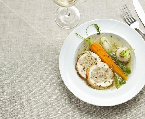 Pork roast stuffed with vegetables,spring vegetable broth