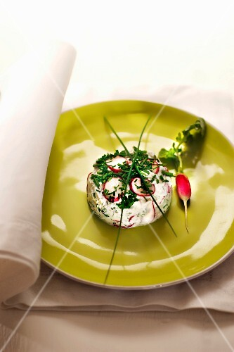 A cream cheese tower with chives and radishes