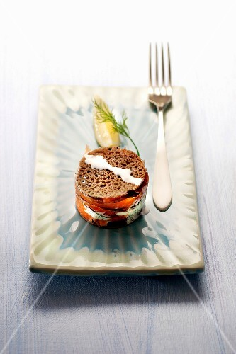 A buckwheat galette layered tartlet with fresh salmon and dill cream