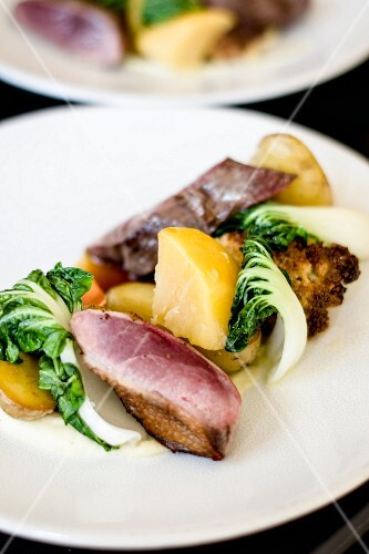 Duck with potatoes, chard and grilled cauliflower