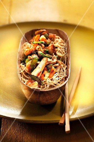 Chinese noodles with chicken,herbs and vegetables