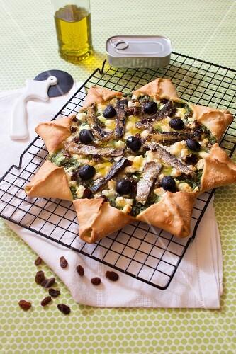 Spinach,feta and sardine star pizza
