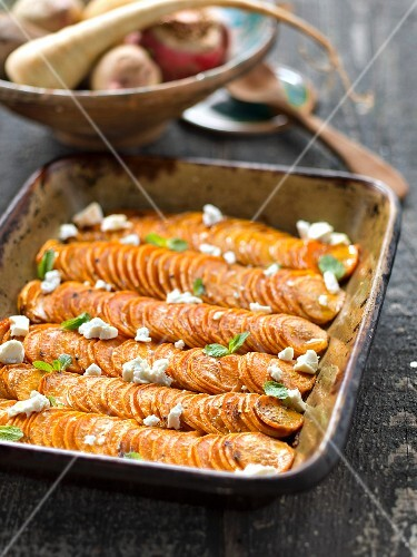 Sweet baked potatoes with feta and mint