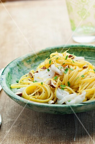 Linguini with fish,lemon zests and crushed hazelnuts