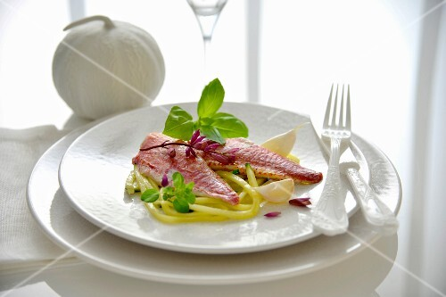 Red mullet fillets thin strips of courgettes with garlic