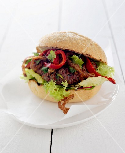 Mexican burger with onions and red peppers