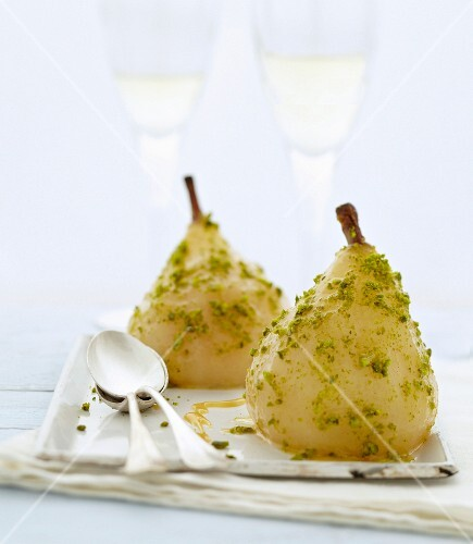 Poached pears with caramel and crushed pistachios