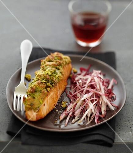 Salmon in pistachio crust, thinly slice Chicorée de Trévise lettuce
