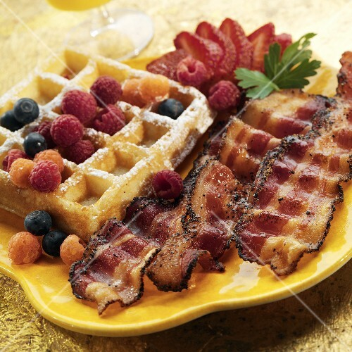 A Waffle with Bacon and Fresh Berries