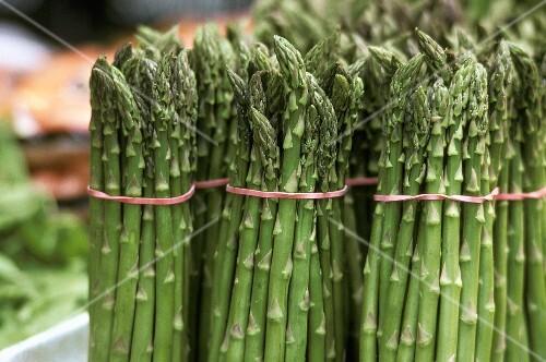 Bundles of Fresh Green Asparagus at the Market