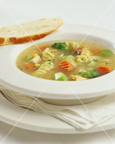 Bowl of Chicken Noodle Soup with a Slice of Bread