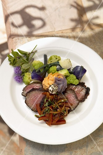 Sliced Sirloin Steak on a White Plate with Vegetables