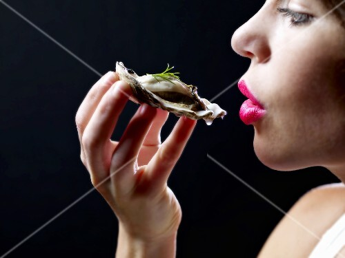 Woman About to Eat an Oyster