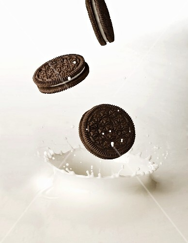 Oreo Cookies Splashing into Milk