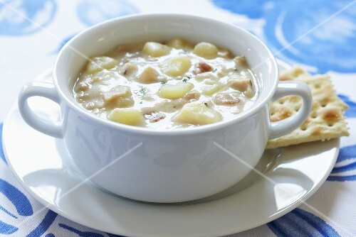 New England Clam Chowder in White Bowl; Crackers