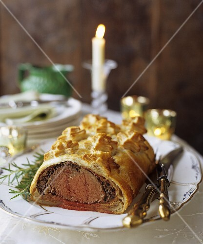 Beef Wellington on a Platter with Carving Utensils