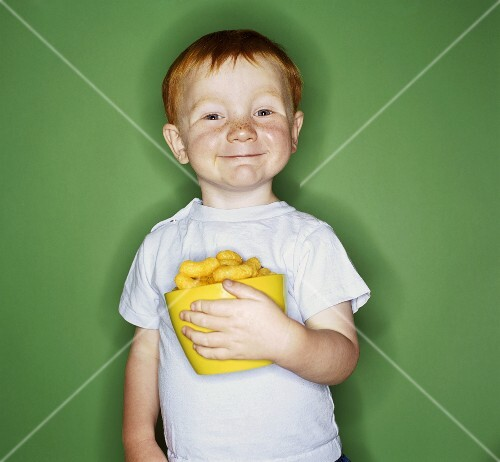 Little Boy Holding a Bowl of Cheetos