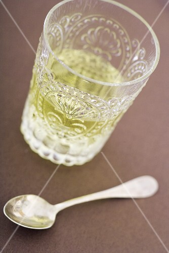 Glass of Absinthe; Spoon