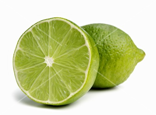 Half and Whole Lime on White Background