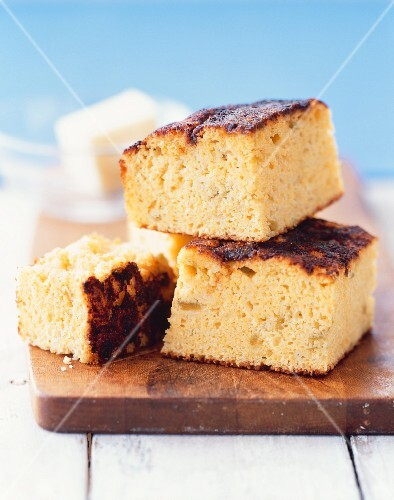 Slices of cornbread on a chopping board