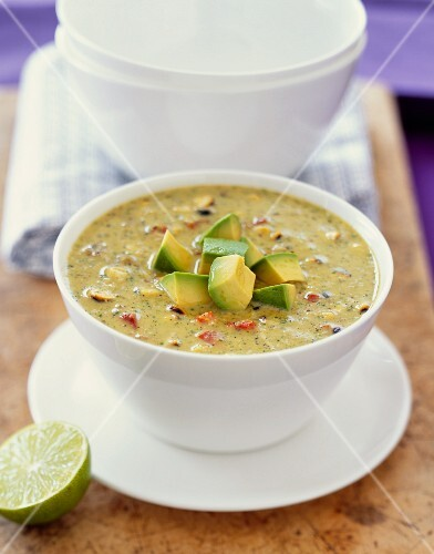 Bowl of Vegetable Soup with Avocado Garnish
