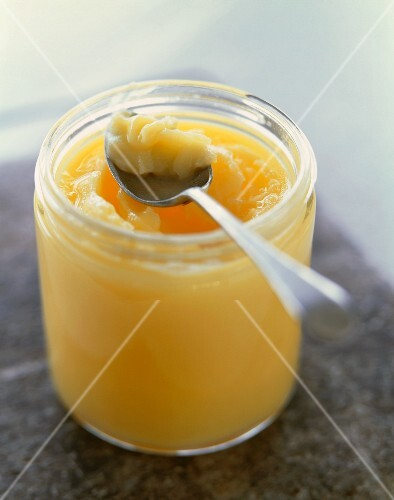 Jar of Ghee with a Spoon