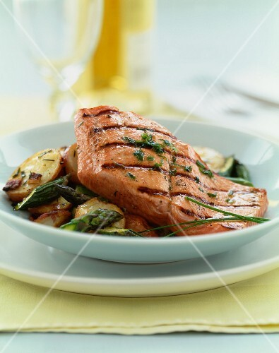 Grilled Salmon on a Bed of Potatoes and Asparagus