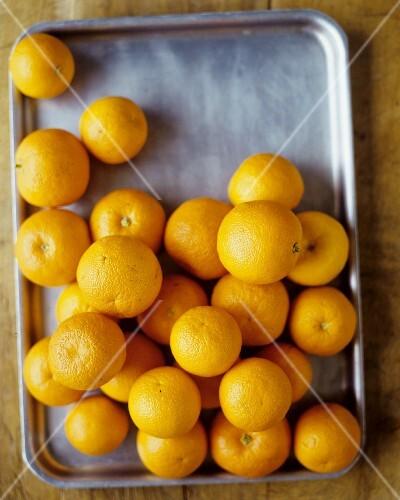 Whole Oranges on a Baking Sheet