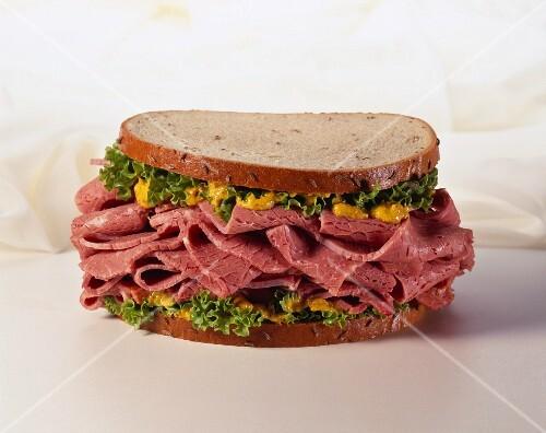 Pastrami Sandwich with Mustard on Rye Bread