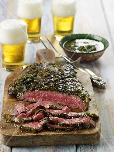 Grilled Flank Steak with Chimichurri Sauce; On Cutting Board; Beer