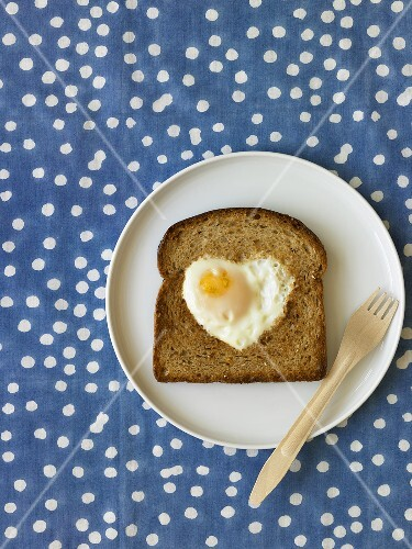 Heart Shaped Fried Egg on Slice of Whole Grain Toast; Fork
