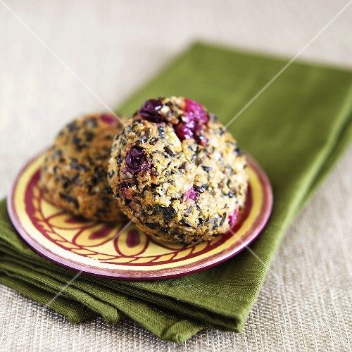 Sweet Potato and Cranberry Quinoa Cakes on a Plate; On Green Folded Napkin