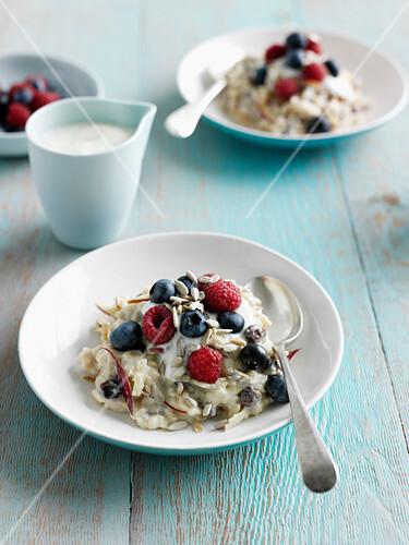 Bowls of fruit and oatmeal. ApplePorridge