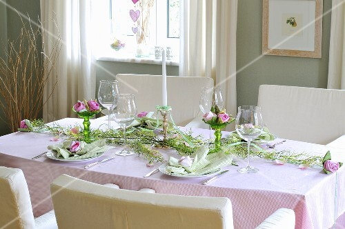A festively decorated dining table with a flower arrangment