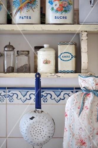 Old-fashioned storage jars on a shelf