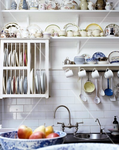 A country-style wall board with crockery and a plate dryer